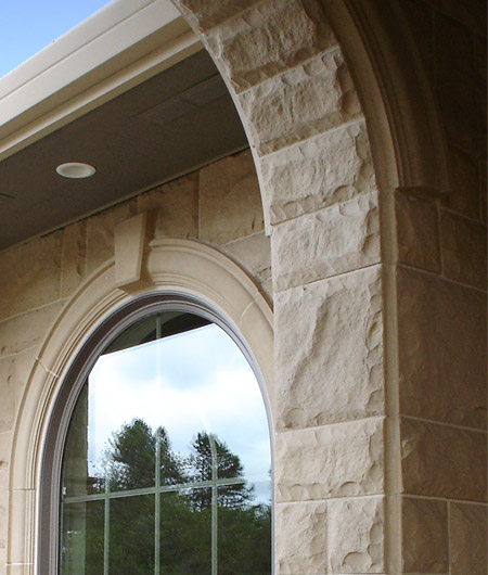 Inside arch finished in Random Chiseled Stone. Looking through to window with Molding #1 (MLD1A3, MLD118S) surround.